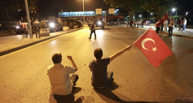 People take the streets in Ankara during a protest against the military coup on July 16, 2016.