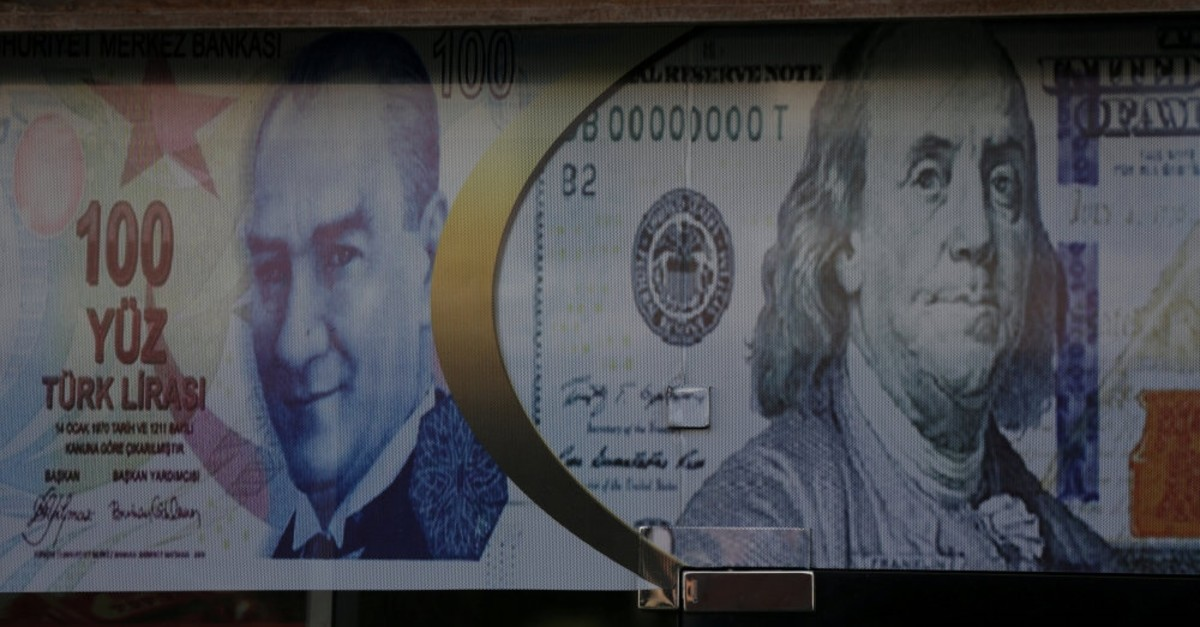 Posters of the Turkish lira and U.S. dollar as seen on a currency exchange shop.