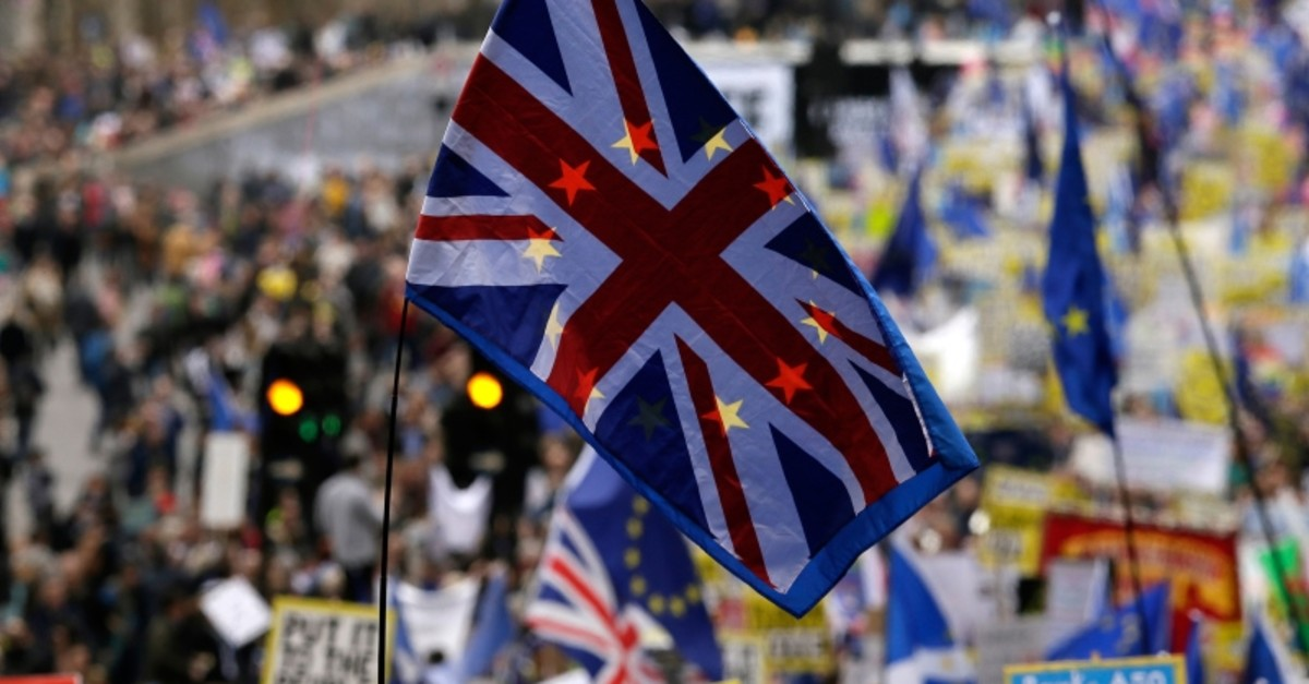 A Union Jack sewn on an EU flag is carried among demonstrators during a Peoples Vote anti-Brexit march in London, Saturday, March 23, 2019. (AP Photo)