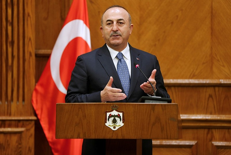 Foreign Minister Mevlu00fct u00c7avuu015fou011flu, speaks during a news conference with his Jordanian counterpart Ayman Safadi in Amman, Jordan, Feb. 19, 2018. (Reuters Photo)