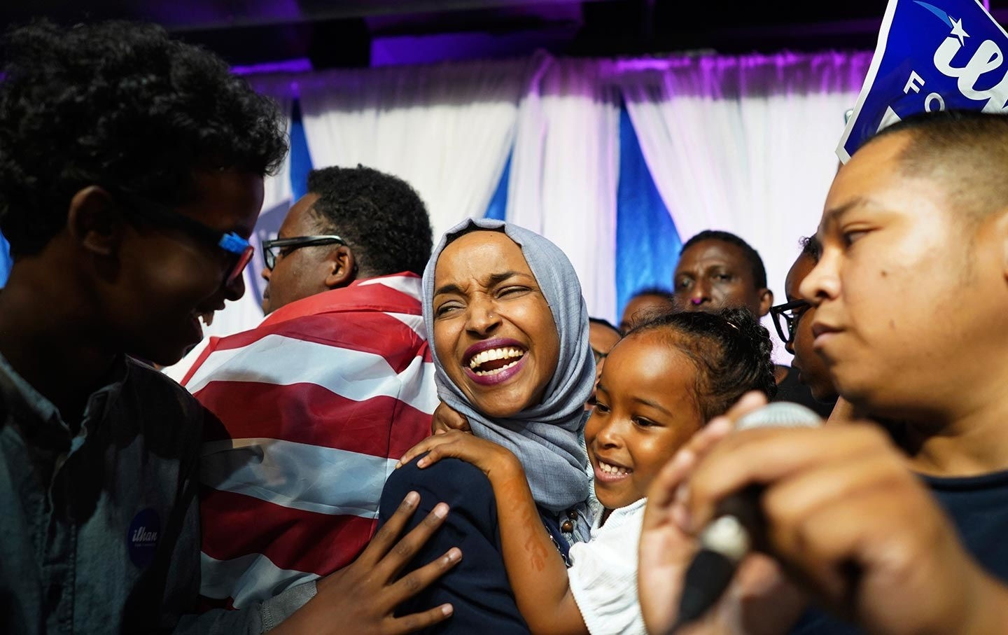 Ilhan Omar, the first Somali-American member of the Congress, celebrates with her children after her victory in Minnesotau2019s Fifth Congressional District in the midterm elections, Aug. 14.