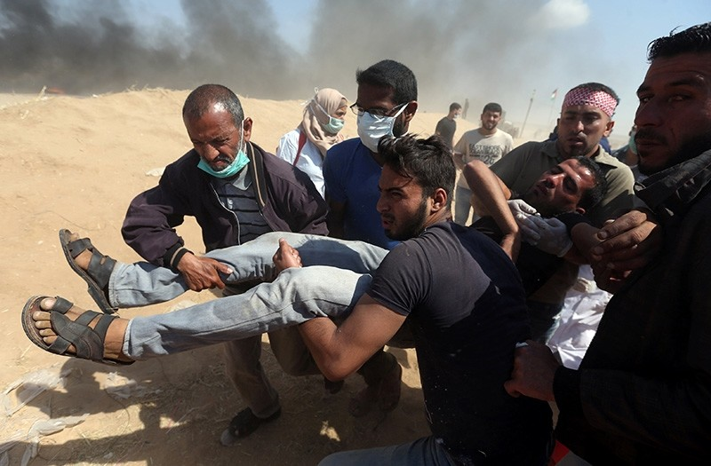 Wounded Palestinian demonstrator is evacuated during a protest marking the 70th anniversary of Nakba, at the Israel-Gaza border in the southern Gaza Strip. (Reuters Photo)