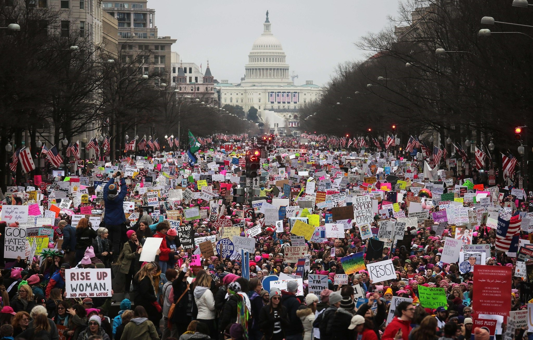 Protesters walk up Pennsylvania Avenue during the Women's March on Washington, with the U.S. Capitol in the background, on January 21, 2017 in Washington, DC. (AFP Photo)