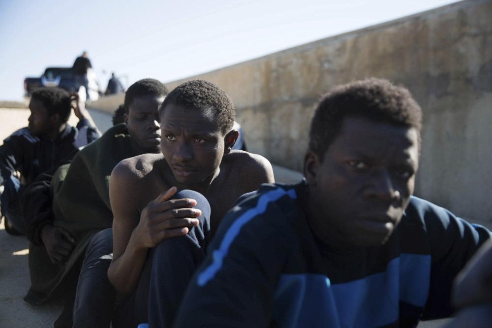 Migrants rest after being rescued by the Coast Guard off the coast of Tripoli, March 3, 2017.