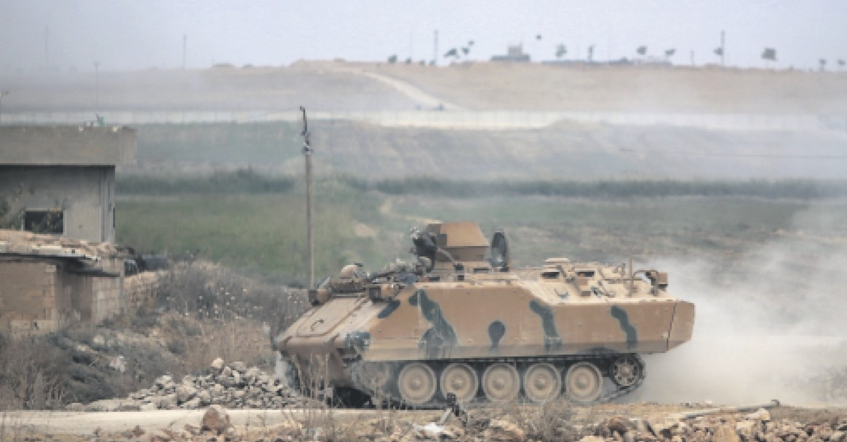 A Turkish military vehicle on the road between the Syrian towns of Tal Abyad and Ayn al-Arab on the Turkish border during the cross-border operation against the Peopleu2019s Protection Units (YPG) terrorist group, Oct. 16, 2019.