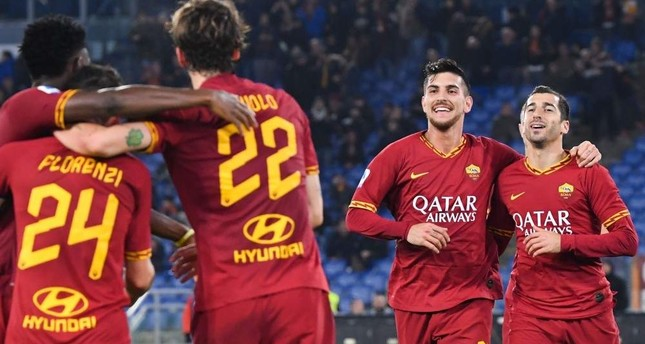 AS Roma players celebrate after scoring against Spal in Rome, Dec. 15, 2019. AFP Photo