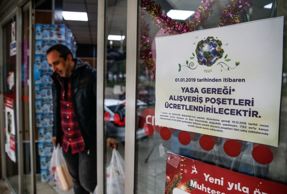 A sign reading ,shopping bags will be charged under new law, at a supermarket in the western city of u0130zmir.