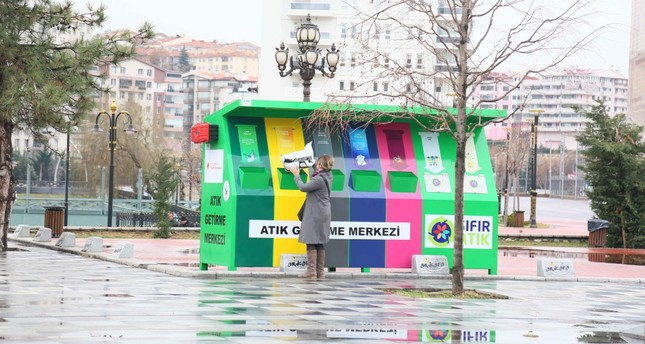 "A woman dumps waste in ""Zero Waste"" dumpsters set up by local municipality in Ankara's Keçiören district."