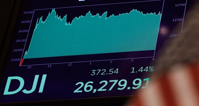 A board above the floor of the New York Stock Exchange shows the closing number for the Dow Jones industrial average, Tuesday, Aug. 13, 2019. (AP Photo)
