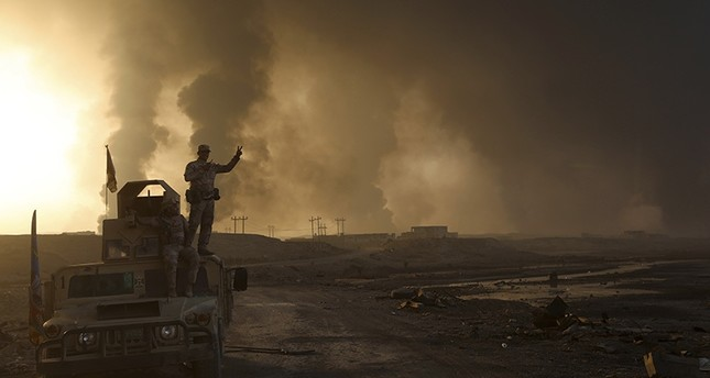 Smoke rises from Daesh positions after an airstrike by coalition forces in Mosul, Iraq, Tuesday, Oct. 18, 2016 (AP Photo)