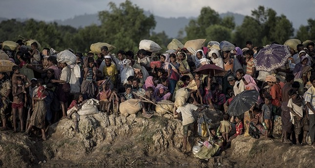 In this file photo taken on Oct. 9, 2017, Rohingya refugees wait after crossing the Naf river from Myanmar into Bangladesh in Whaikhyang. (AFP Photo)