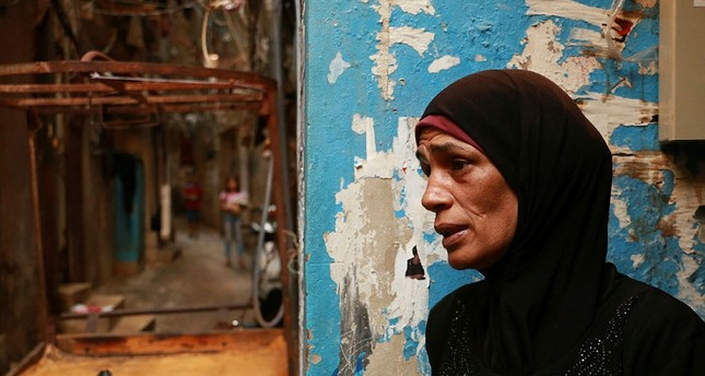 Amal al-Qirmi, 50, one of the survivors of the massacres, talks to Anadolu Agency in Lebanon on September 16, 2017.