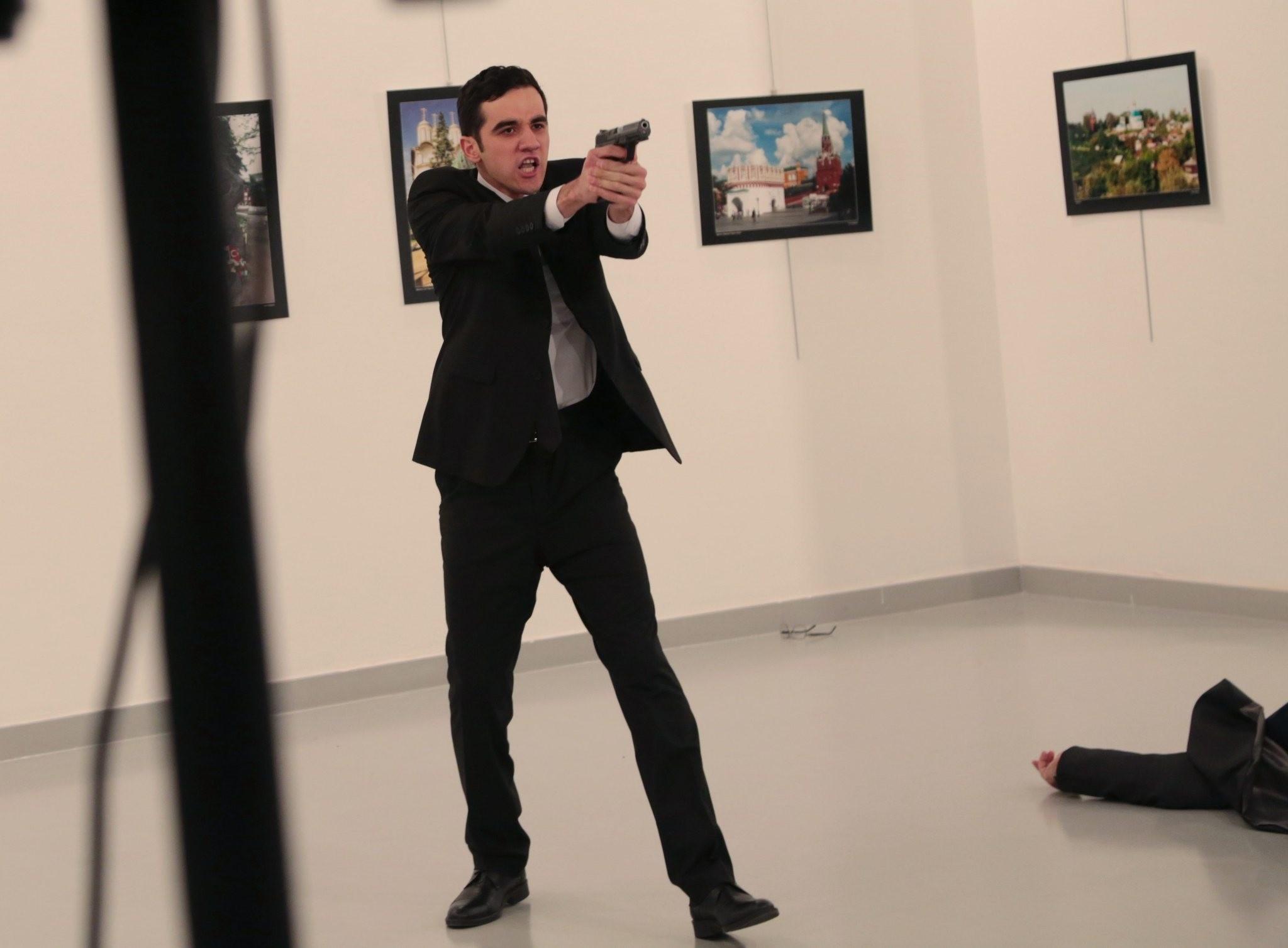 Altu0131ntau015f gestures after shooting the Russian Ambassador to Turkey, Andrei Karlov, at a photo gallery in Ankara, Dec. 19, 2016. (AP Photo)