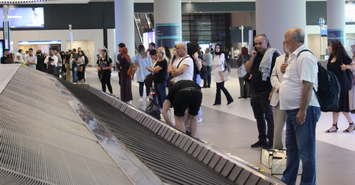 Passengers wait to claim their baggage in front of a carousel in Istanbul Airport, June 22, 2019. (AA Photo)