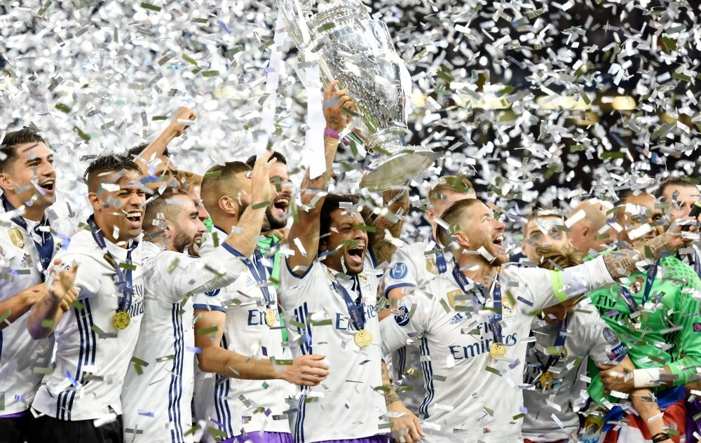 Real Madrid player Marcelo lifts the trophy after the UEFA Champions League final between Juventus FC and Real Madrid at the National Stadium of Wales in Cardiff.
