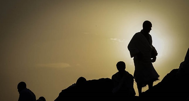 Muslim worshippers are silhouetted against the sunrise during the Hajj pilgrimage on the Mount Arafat, near Mecca, Saudi Arabia, 31 August 2017 (EPA Photo)