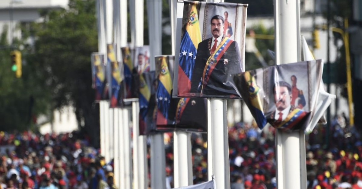 Posters depicting Venezuelan President Nicolas Maduro are seen during a May Day rally in Caracas, Venezuela, May 1, 2019.
