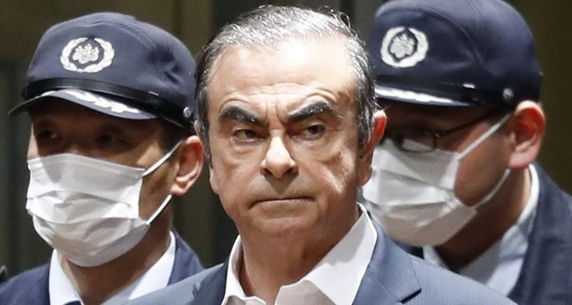 In this April  25, 2019, file photo, former Nissan Chairman Carlos Ghosn leaves Tokyo's Detention Center for bail in Tokyo. AP, File