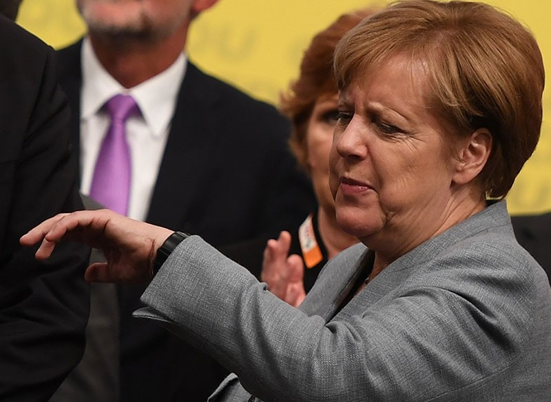 erman Chancellor Angela Merkel take a look at her watch after a campaign event of Christian Democratic Union (CDU), in Osnabrueck, Germany, 13 October 2017 (EPA Photo)
