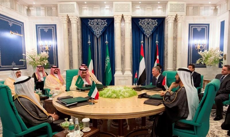 From left to right at the round table, Kuwaiti Emir Sheikh Sabah Al Ahmad Al Sabah, Saudi King Salman, Jordan's King Abdullah II, and UAE's VP and PM, Dubai ruler Sheikh Mohammed bin Rashid Al Maktoum, meet in Mecca, June 11, 2018. (SPA via AP)