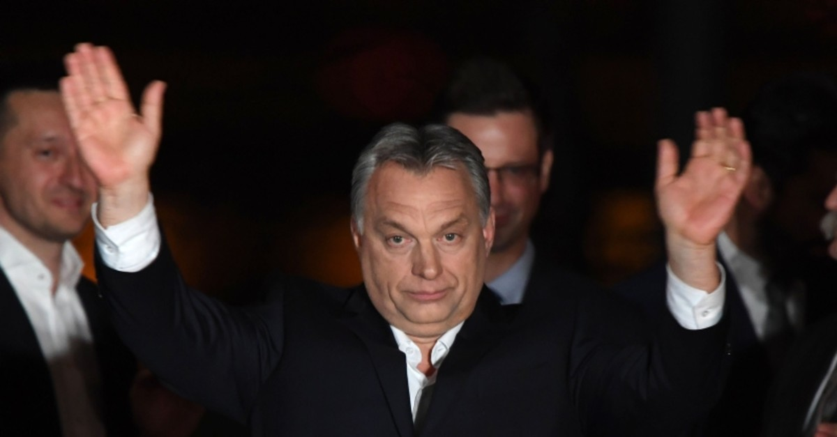 Hungarian Prime Minister Viktor Orban (C) celebrates on podium on the bank of the Danube River after winning the parliamentary election with members of his FIDESZ party on April 8, 2018 in Budapest. (AFP Photo)