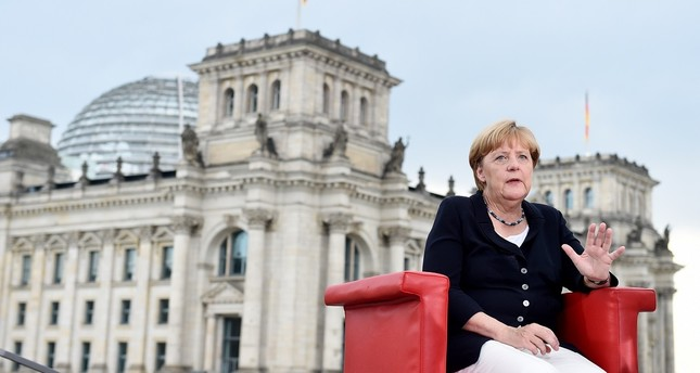 German Chancellor Angela Merkel speaks during an interview by ARD TV presenters Tina Hassel and Thomas Baumann, in Berlin, Aug. 28. (AP Photo)