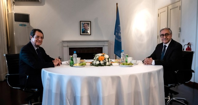Turkish Cypriot leader Mustafa Akıncı, right, and Greek Cypriot leader Nicos Anastasiades pose for a photo during their meeting at a U.N compound inside the U.N buffer zone in divided capital Nicosia, Cyprus, Tuesday, Feb. 26, 2019. (AP Photo)