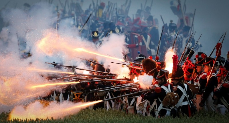 This file photo shows re-enactors perform on the battlefield during the first reenactment of 'The French Attack' during the bicentennial celebrations for the Battle of Waterloo, in Braine l'Alleud, Belgium, June 19, 2015. (EPA Photo)