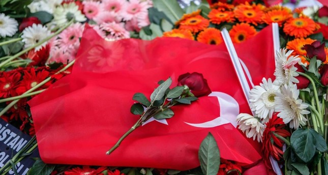 Locals paid tribute to the victims of the recent terror attack in Beşiktaş by leaving flowers and Turkish flags at the scene.