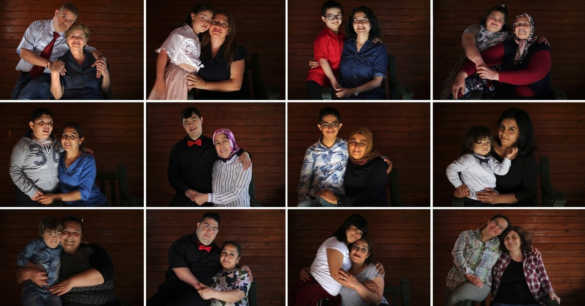 Mothers pose with their children with Down syndrome in a photo shoot for Anadolu Agency, May 11, 2019.