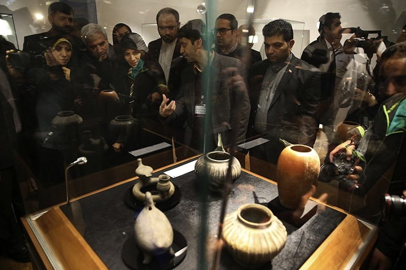 Iranian officials listen to explanations from archaeologist Yousef Hassanzadeh during the opening of a show displaying some 550 ancient Persian artworks returned by Western countries at Iran National Museum in Tehran on Feb. 6, 2017. (AP Photo)
