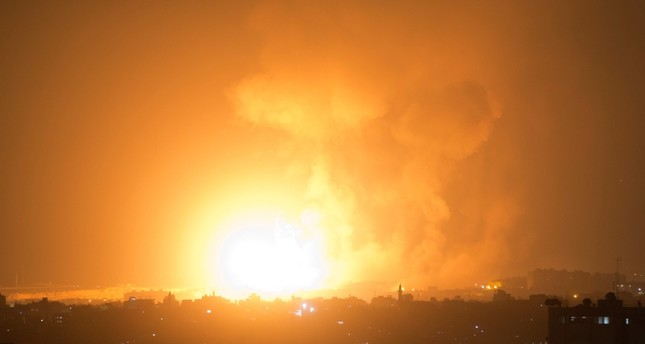 An explosion caused by Israeli airstrikes on Gaza City, early Thursday, Aug. 9, 2018. (AP Photo)