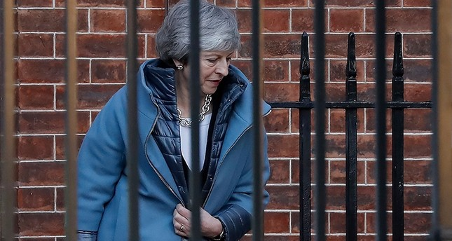 Britain's Prime Minister Theresa May leaves from the rear of 10 Downing Street in London on February 14, 2019 ahead of a vote on amendments to the Brexit withdrawal bill. (AFP Photo)