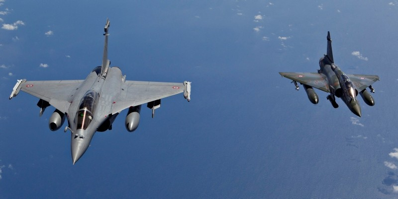 A file handout photograph issued by the French Ministry of Defense on March 31, 2011 shows a French Mirage 2000D (R) and a French Rafale fighter jet in flight, at an undisclosed location, March 30, 2011. (EPA Photo)
