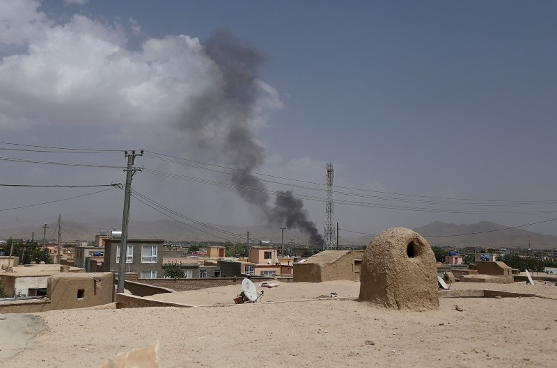 Smoke rising into the air after Taliban militants launched an attack on the Afghan provincial capital of Ghazni on August 10, 2018. (AFP Photo)