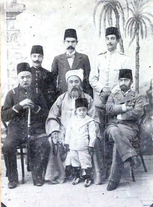 Ebubekir Efendi, sitting in the middle, was a respected scholar and an influential figure among Muslim communities.