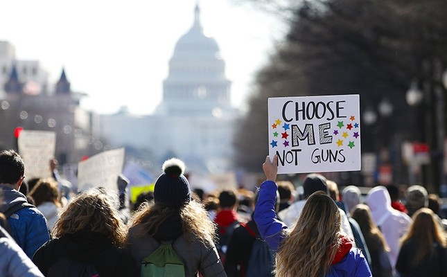 After a rally in front of the White House, students march up Pennsylvania Avenue toward Capitol Hill in Washington, Wednesday, March 14, 2018. (AP Photo)