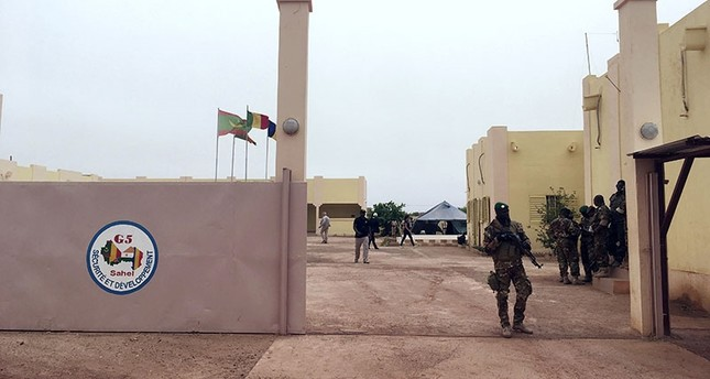 In this Wednesday, May 30, 2018 file photo, a member of the army stands guards at the entrance of the headquarters of a new, five-nation West African counter-terror force, in Mali. (AP Photo)