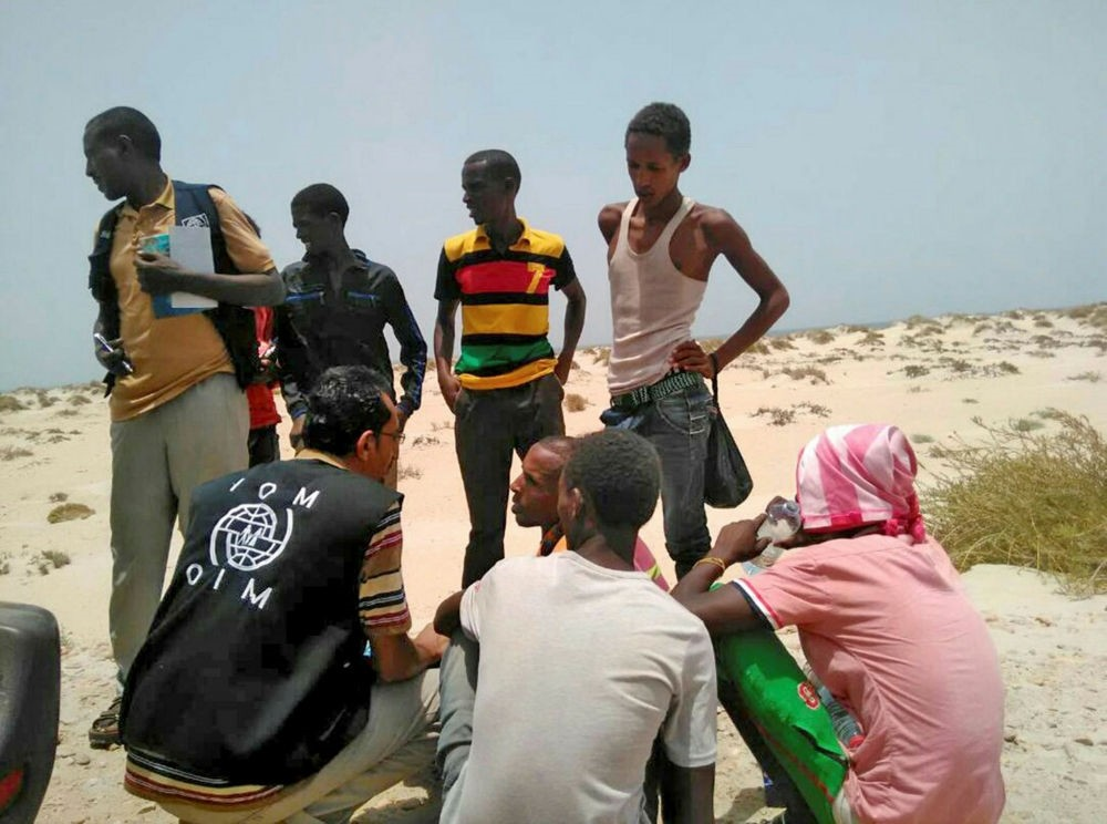 IOM staff assist Somali and Ethiopian migrants who were reportedly forced into the sea by smugglers, on a beach in Shabwa, Yemen, Aug. 10.