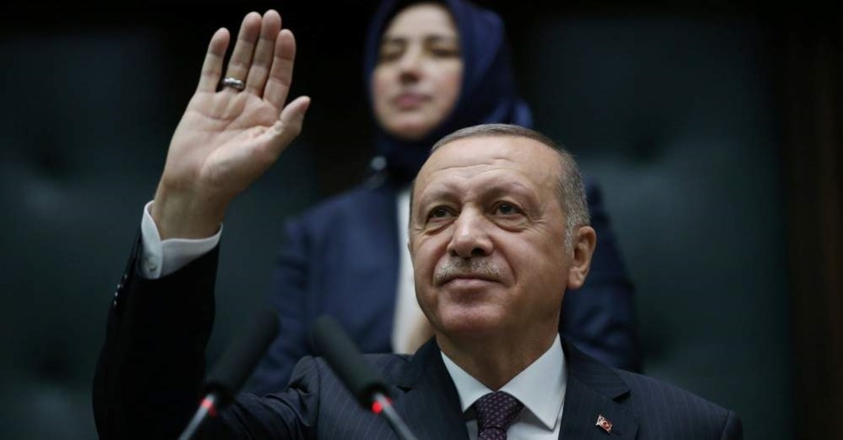 President Recep Tayyip Erdo?an greets lawmakers from his ruling AK Party during a meeting at Parliament in Ankara, Nov. 19, 2019.