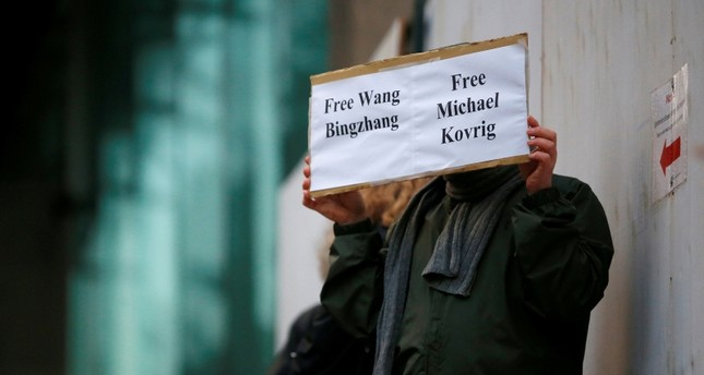 A man holds a sign calling for China to release Wang Bingzhang and former Canadian diplomat Michael Kovrig, at the B.C. Supreme Court bail hearing of Huawei CFO Meng Wanzhou in Vancouver, British Columbia, Canada Dec. 11, 2018. (Reuters Photo)