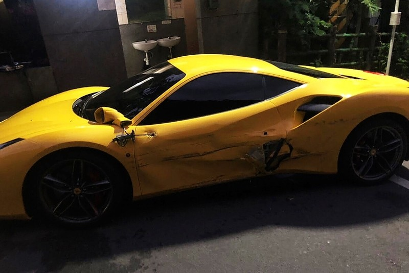 A handout photo taken on Dec. 17, 2018 and released by New Taipei City Police Department on Dec. 20, 2018 shows one of the three damaged Ferraris in Taipei. (AFP Photo)