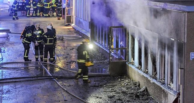 Firemen work outside a still smoking cellar mosque in Eskilstuna, Sweden, Thursday, Dec. 25, 2014. AP Photo