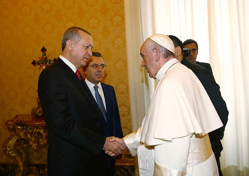 President Recep Tayyip Erdou011fan shaking hands with Pope Francis during his official visit to the Vatican City, Feb. 5, 2018. (AA Photo)