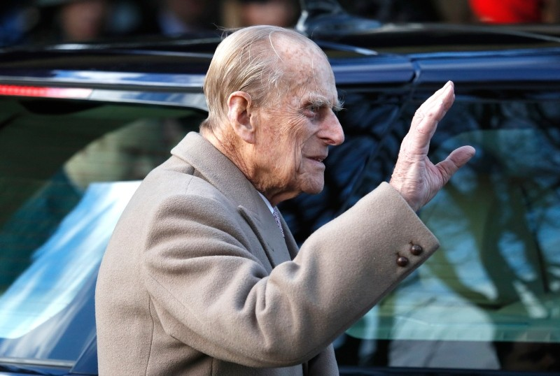 In this Sunday, Dec. 25, 2016 file photo, Britain's Prince Philip waves to the public as he leaves after attending a Christmas day church service in Sandringham, England. (AP Photo)