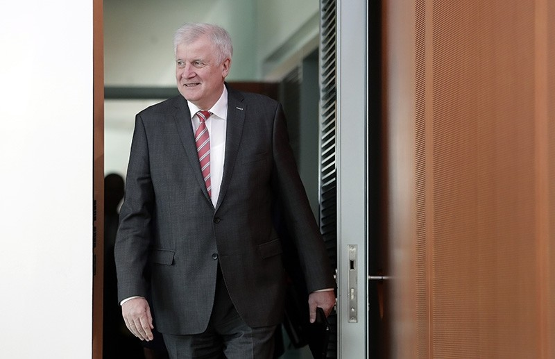 German Interior Minister Horst Seehofer arrives for the weekly cabinet meeting at the chancellery in Berlin, Germany, Wednesday, Sept. 26, 2018. (AP Photo)