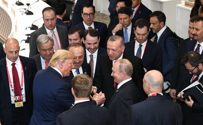 President Recep Tayyip Erdoğan (C), U.S. President Donald Trump (L) and Russian President Vladimir Putin (R) have a quick talk during the G20 summit of world leaders in Osaka, Japan, June 30, 2019.