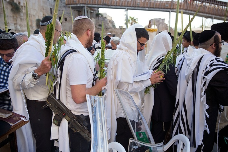 Israeli Ultra-orthodox Jews of the Cohanim Priestly caste participate in a blessing as they hold the four items used during the Jewish holiday of Sukkot, inside Al-Aqsa Mosque Complex, Oct. 8, 2017. (AP Photo)