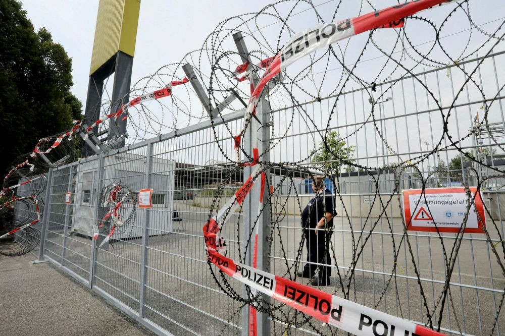 Police razor wire at the entrance of a provisional collection center for arrestees during the G20 summit in Hamburg-Harburg, northern Germany, June 20.