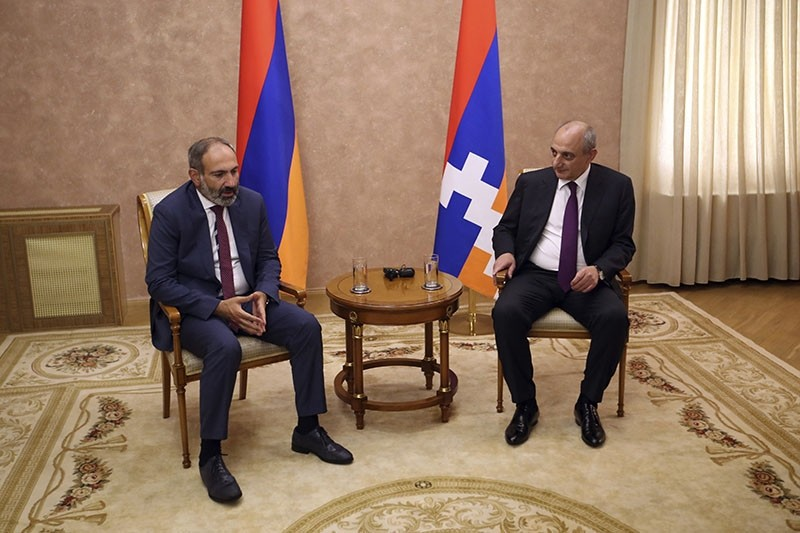 Armenia's Prime Minister Nikol Pashinian, left, and the President Bako Sahakyan of the separatist Nagorno-Karabakh region speak during their meeting in the capital Stepanakert, Wednesday, May 9, 2018. (AP Photo)